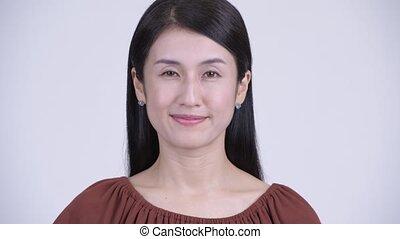 Face of happy beautiful Asian woman nodding head yes -...