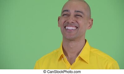 Face of happy handsome bald businessman thinking - Studio...