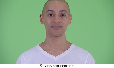Face of happy handsome bald man nodding head yes - Studio...