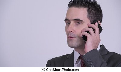 Face of happy handsome businessman talking on the phone