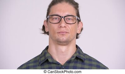 Face of happy hipster man smiling while wearing eyeglasses -...