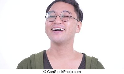 Face of happy Japanese man relaxing with eyes closed