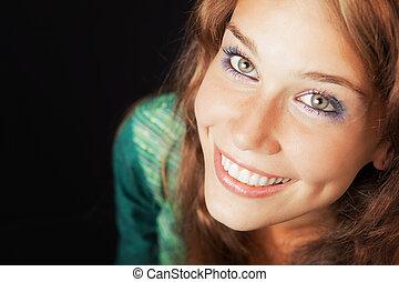 Face of happy joyful young friendly woman