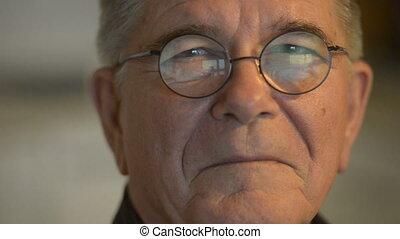 Face of happy senior man with eyeglasses indoors - Portrait ...