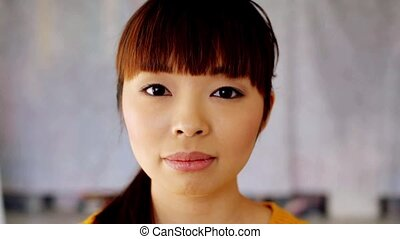 face of happy smiling asian young woman