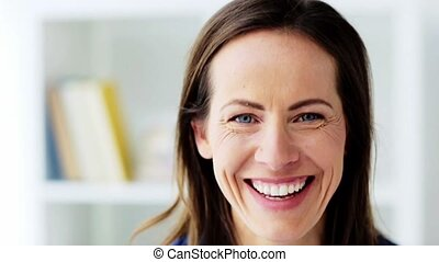 face of happy smiling middle aged woman - people, emotion...