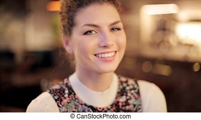face of happy smiling young redhead woman - people, emotion...