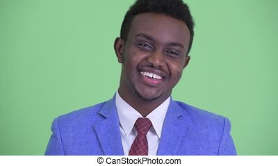 Face of happy young African businessman nodding head yes -...