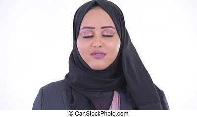 Face of happy young African Muslim businesswoman relaxing...