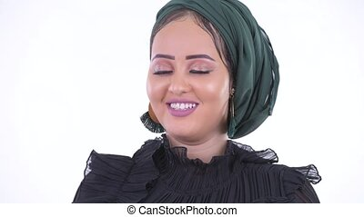 Face of happy young African Muslim woman relaxing with eyes...