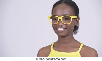 Face of happy young beautiful African woman thinking with yellow eyeglasses
