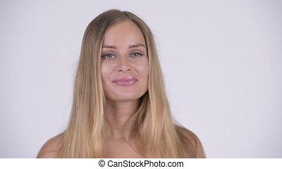 Face of happy young beautiful blonde woman in bikini nodding head yes