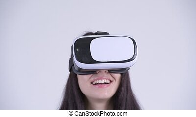 Face of happy young beautiful woman using virtual reality...