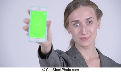 Face of happy young blonde businesswoman showing phone -...