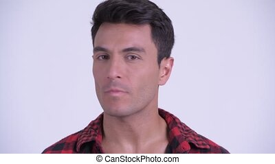 Face of happy young Hispanic hipster man nodding head no -...