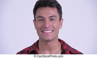 Face of happy young Hispanic hipster man nodding head yes -...