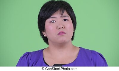 Face of happy young overweight Asian woman nodding head yes...