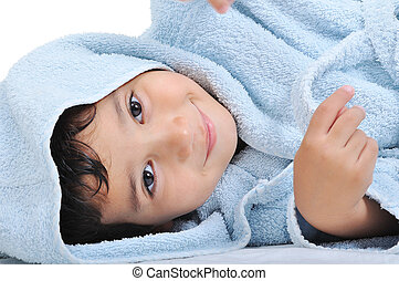 Face of innocence itself, happy childhood in robe, isolated