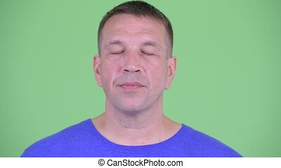 Face of macho mature man relaxing with eyes closed