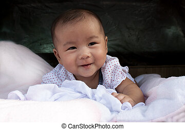 face of new born infant on the bed