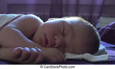 face of newborn sleeping