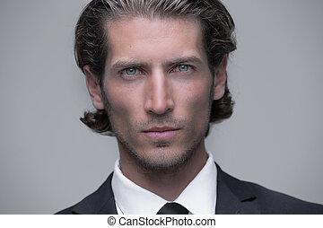 face of responsible business men - closeup face of...