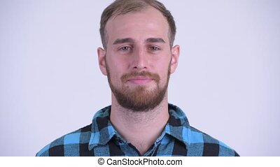 Face of serious bearded hipster man nodding head no - Studio...