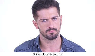 Face of serious young bearded hipster man nodding head no -...