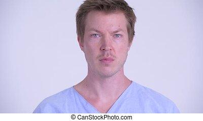 Face of serious young man patient nodding head no - Studio...