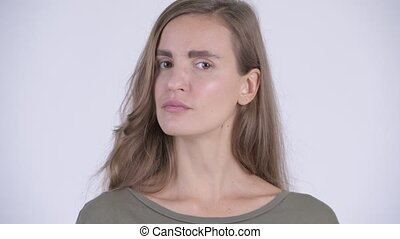 Face of serious young stressed woman nodding head no -...