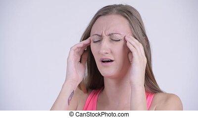 Face of stressed blonde woman having headache
