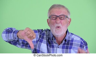 Face of stressed senior bearded hipster man getting bad news