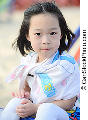 face of the beautiful Asian girl on a beach