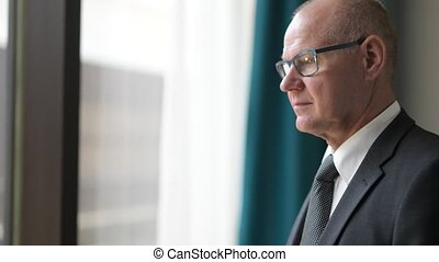Face Of Thoughtful Senior Businessman Planning And Looking Through The Window