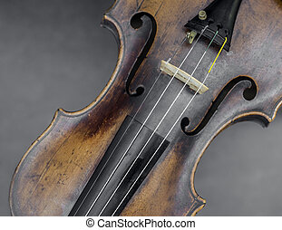 face of violin against gray background in closeup
