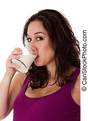 Beautiful face of a Caucasian Hispanic Latina female brunette woman drinking milk, isolated. Milk is a great source of vitamine D and Calcium and promotes bone health fighting osteoporosis.