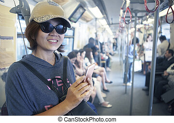 face of woman in sky train with sma