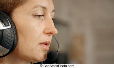 Face of woman working as hotline consultant. Callcenter...
