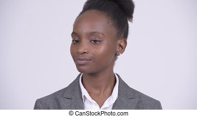 Face of young African businesswoman nodding head no - Studio...