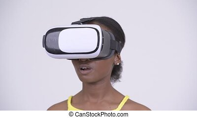 Face of young African woman using virtual reality headset