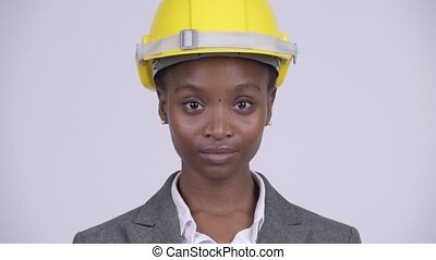 Face of young beautiful African businesswoman wearing...