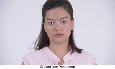 Face of young beautiful Asian businesswoman