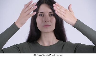 Face of young beautiful woman covering eyes as three wise...