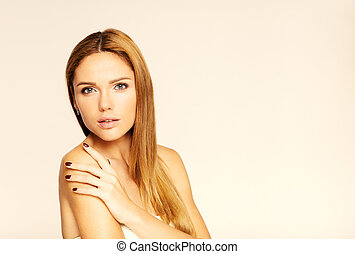 face of young beautiful woman with clean skin. White background
