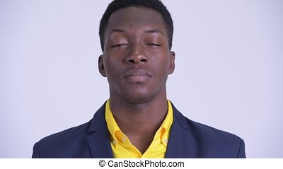 Face of young handsome African businessman in suit