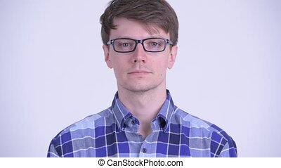 Face of young handsome hipster man showing three wise...