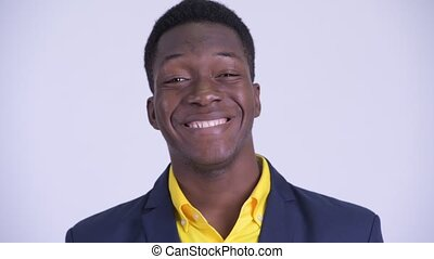 Face of young happy African businessman in suit smiling