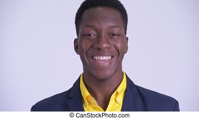 Face of young happy African businessman nodding head yes -...