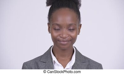 Face of young happy African businesswoman nodding head yes -...