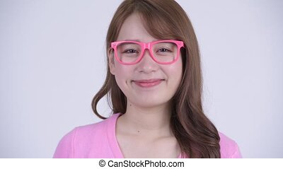 Face of young happy Asian nerd woman smiling